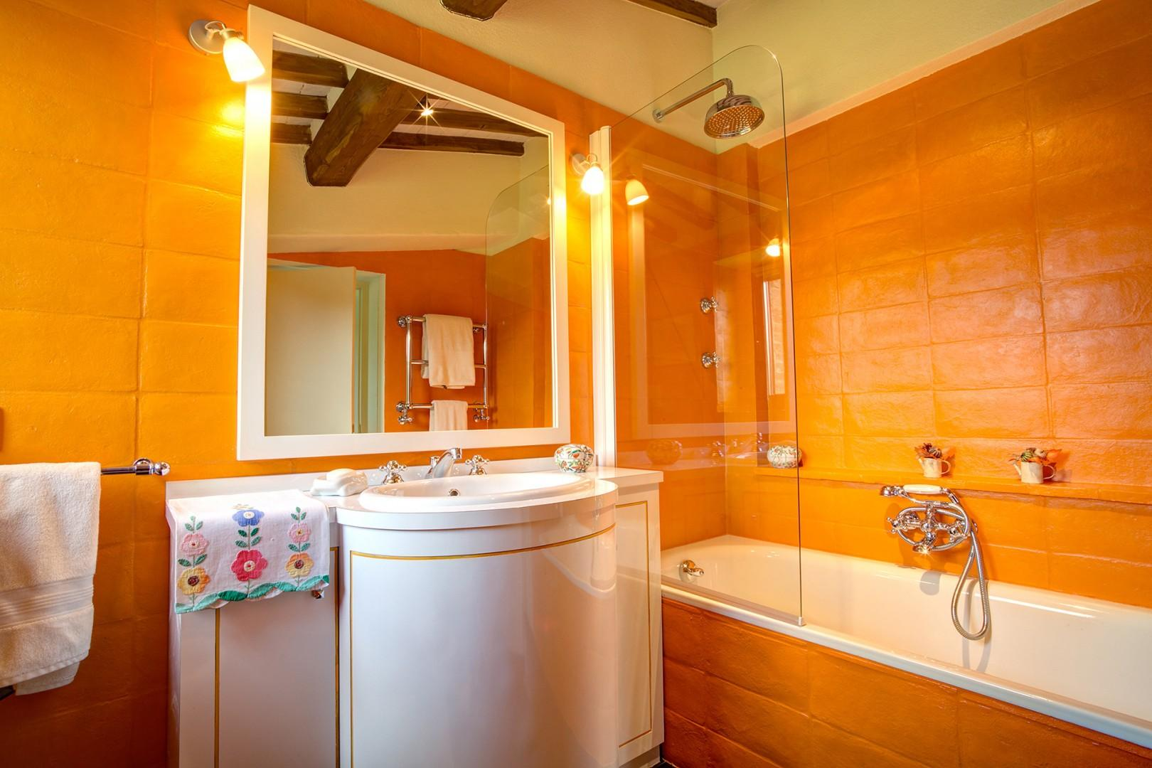 This bathroom has a combination bathtub/shower with rainfall showerhead.