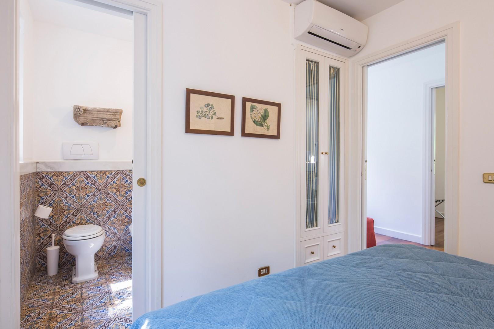 Bedroom 2 view towards en suite bathroom.
