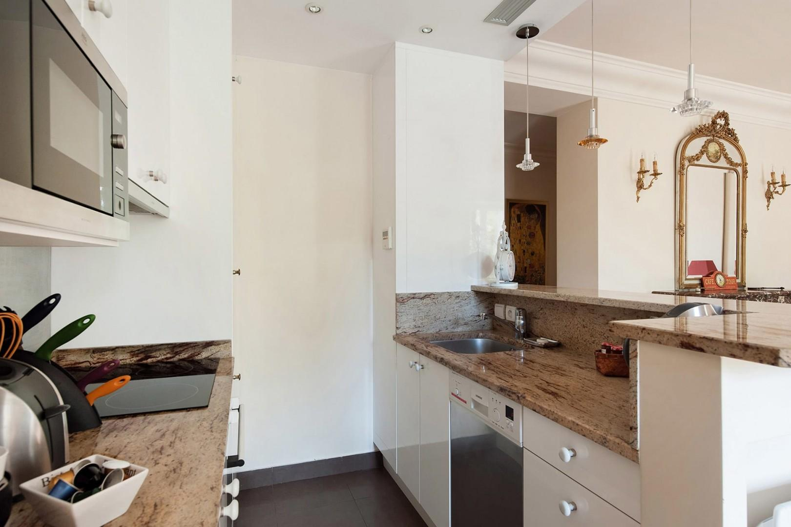 All necessary appliances are at your disposal in this modern kitchen.
