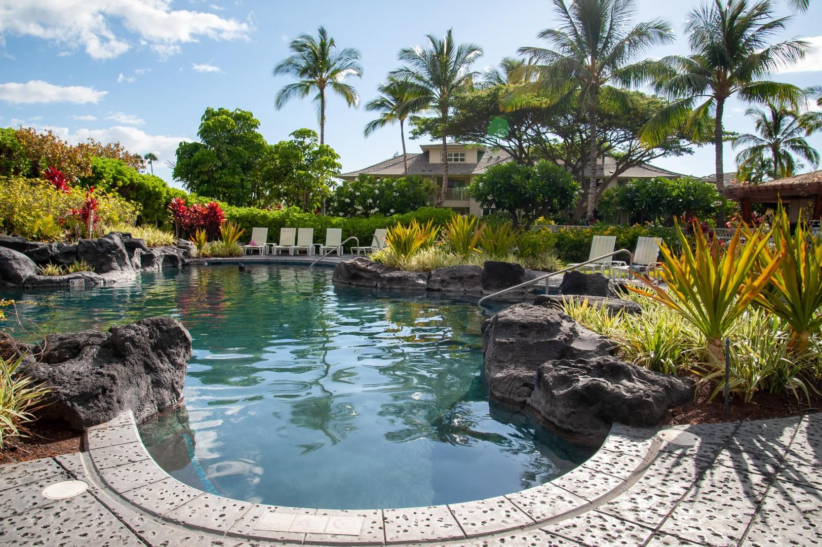Inviting Free-Form Swimming Pool w/ Waterfall Directly Across From Villa