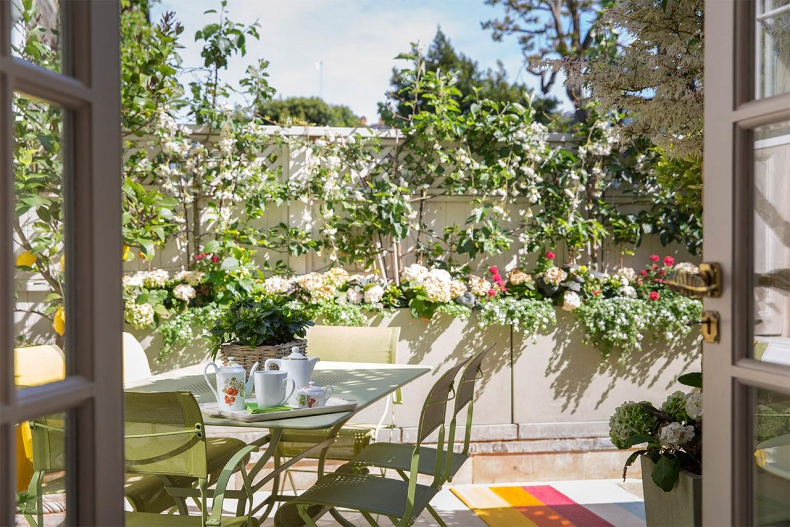 Outdoor dining is a special occasion on this lovely terrace