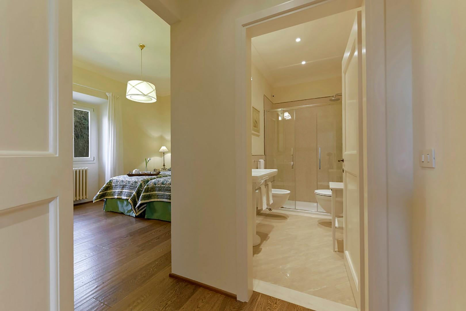 En suite bathroom 4 with a large shower.