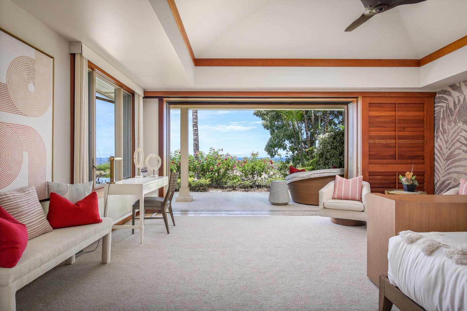 Ample seating including a desk + pocket doors to the master suite's own private lanai.