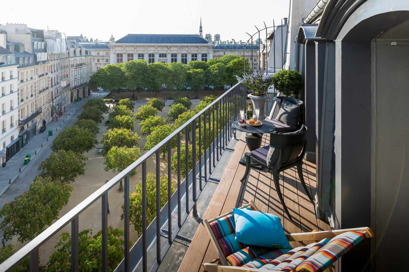 Enjoy your private balcony with a view of Place Dauphine and tip of Notre-Dame!