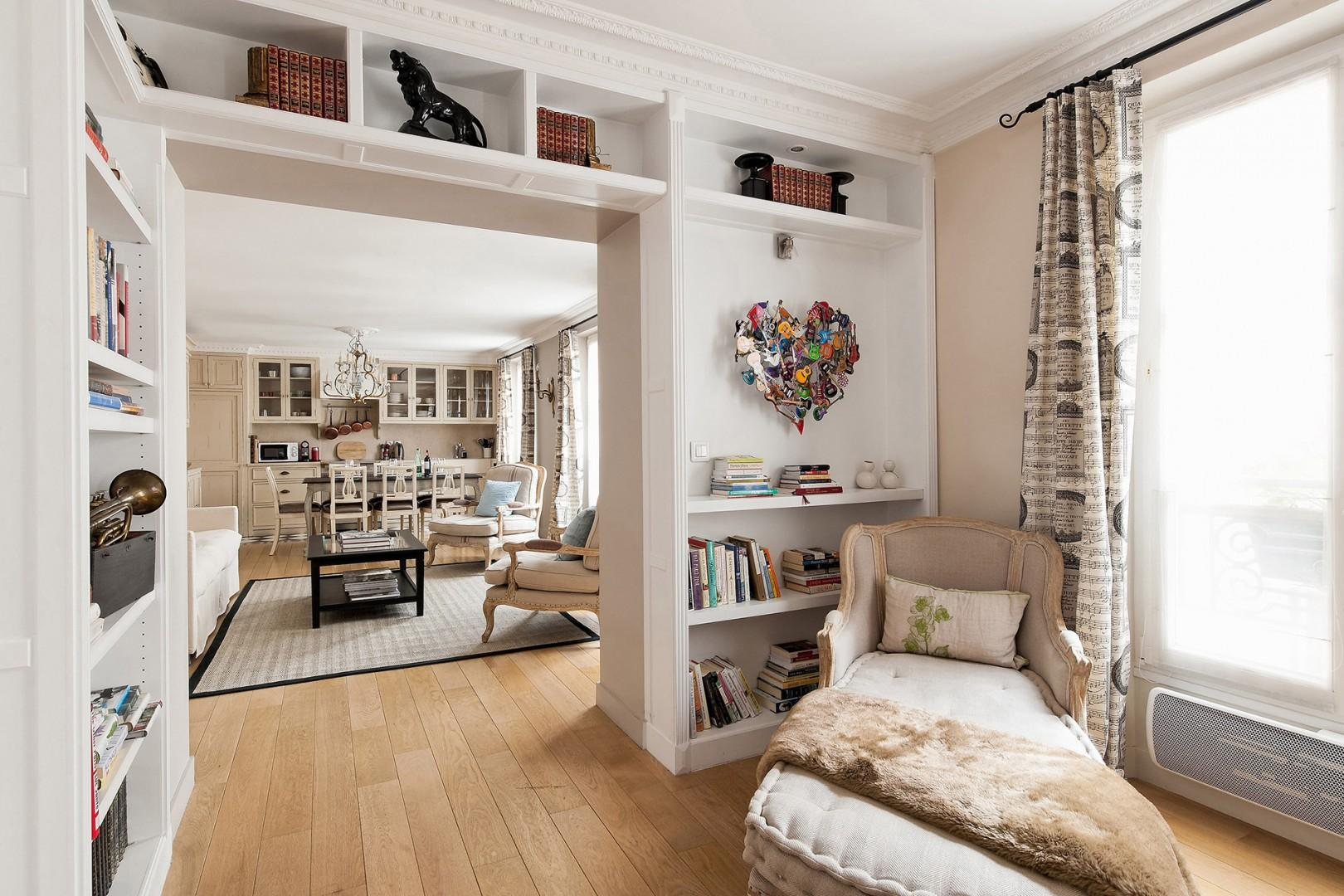 The bright sitting room is the perfect spot to curl up with a book!
