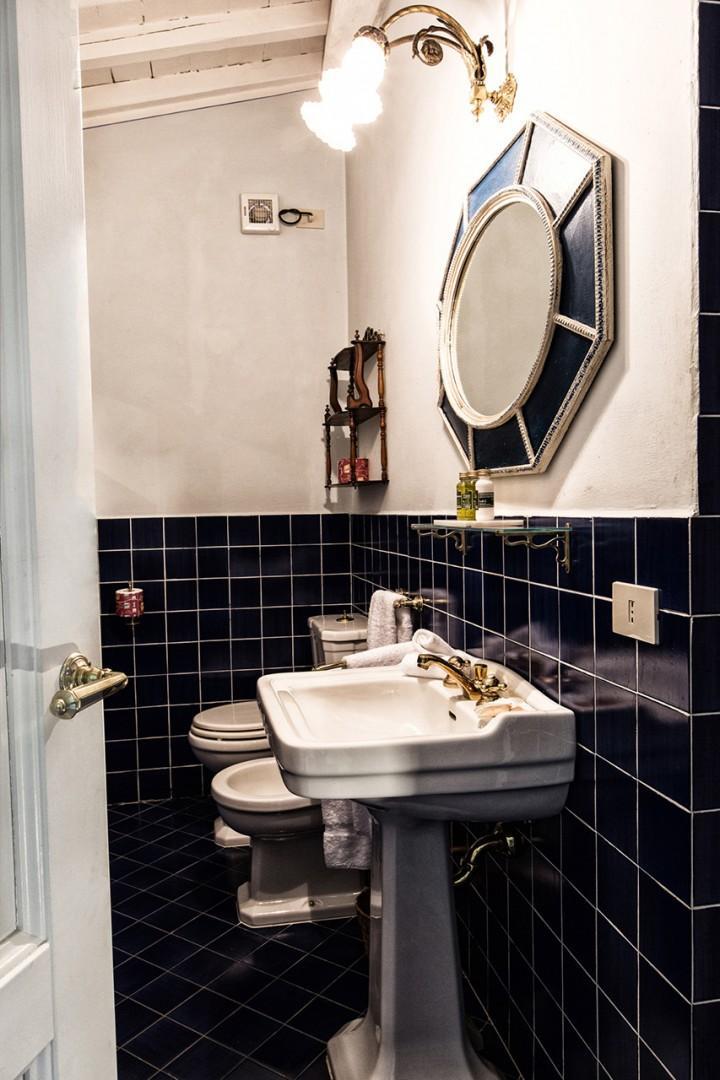 En suite bathroom 1 with sink, toilet, bidet and shower.