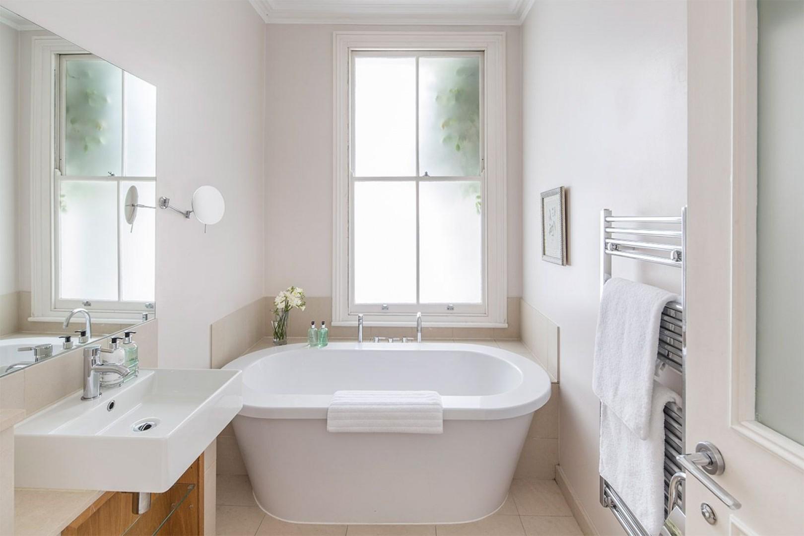 Enjoy a long soak in the luxurious tub in the en suite bathroom