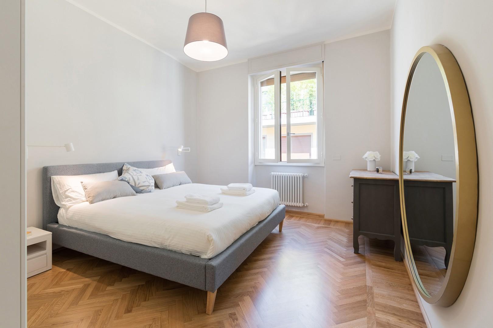 Bedroom 1 with comfortable bed and en suite bathroom.