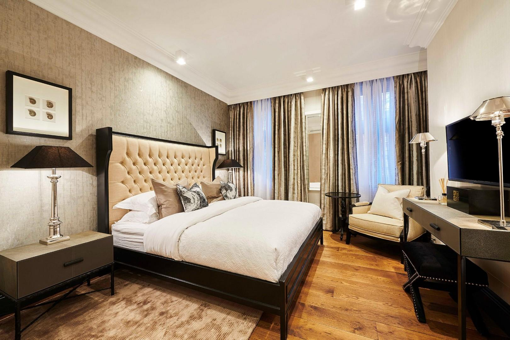 Sumptuous first bedroom with designer furnishings
