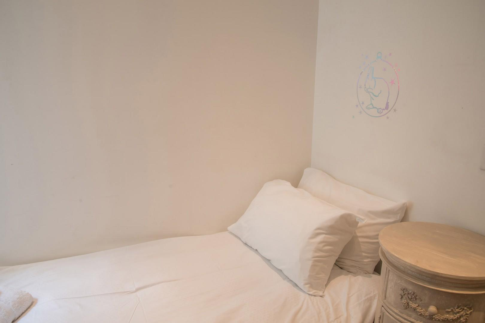 Bedroom 3 is crisp and plush.
