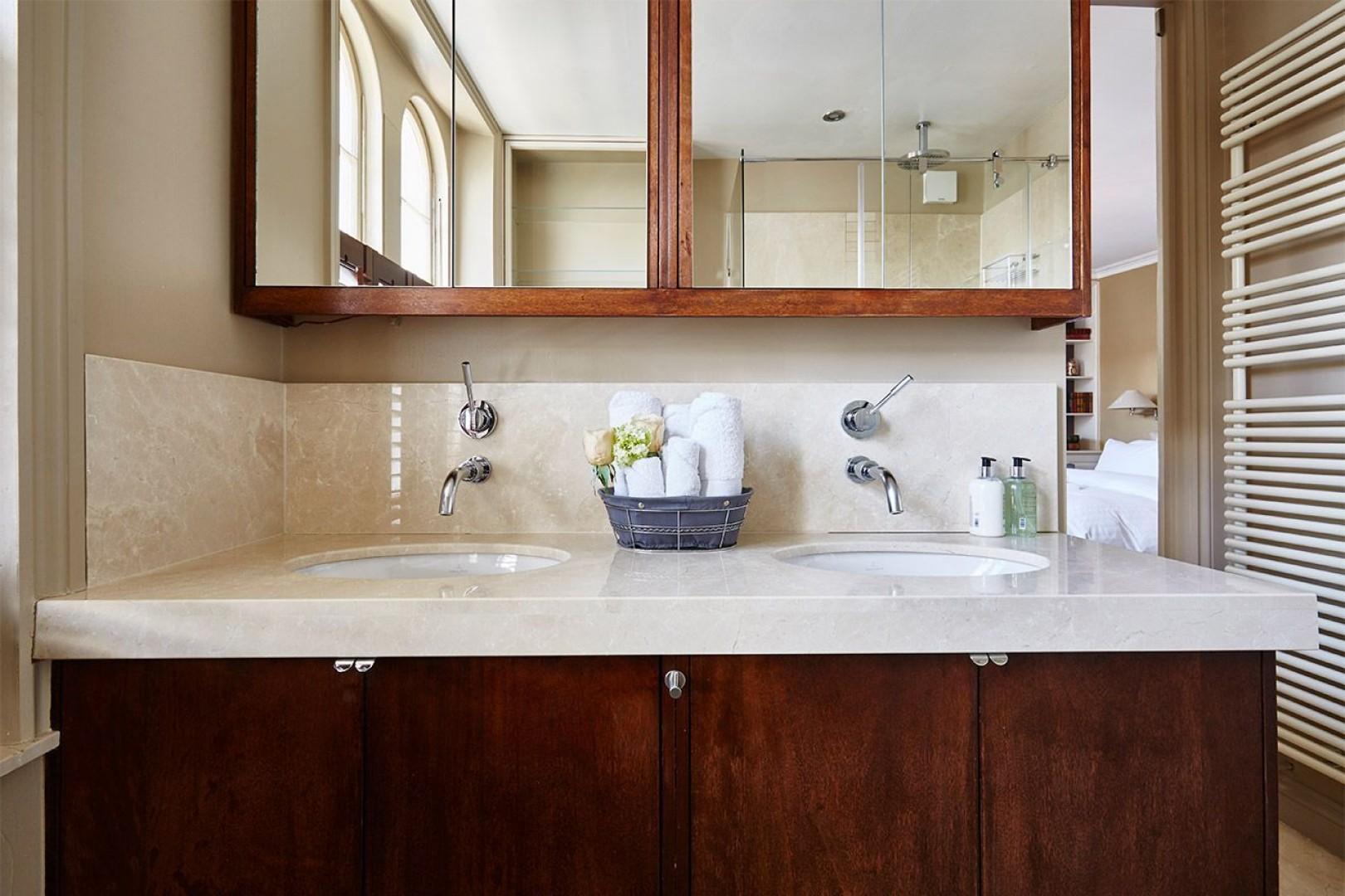 Dual sinks in the first en suite bathroom