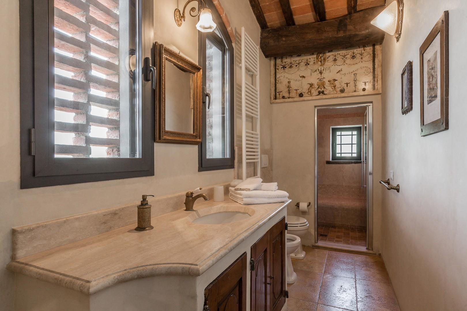 En suite bathroom to bedroom 1 has a large shower and good countertop space around the sink.