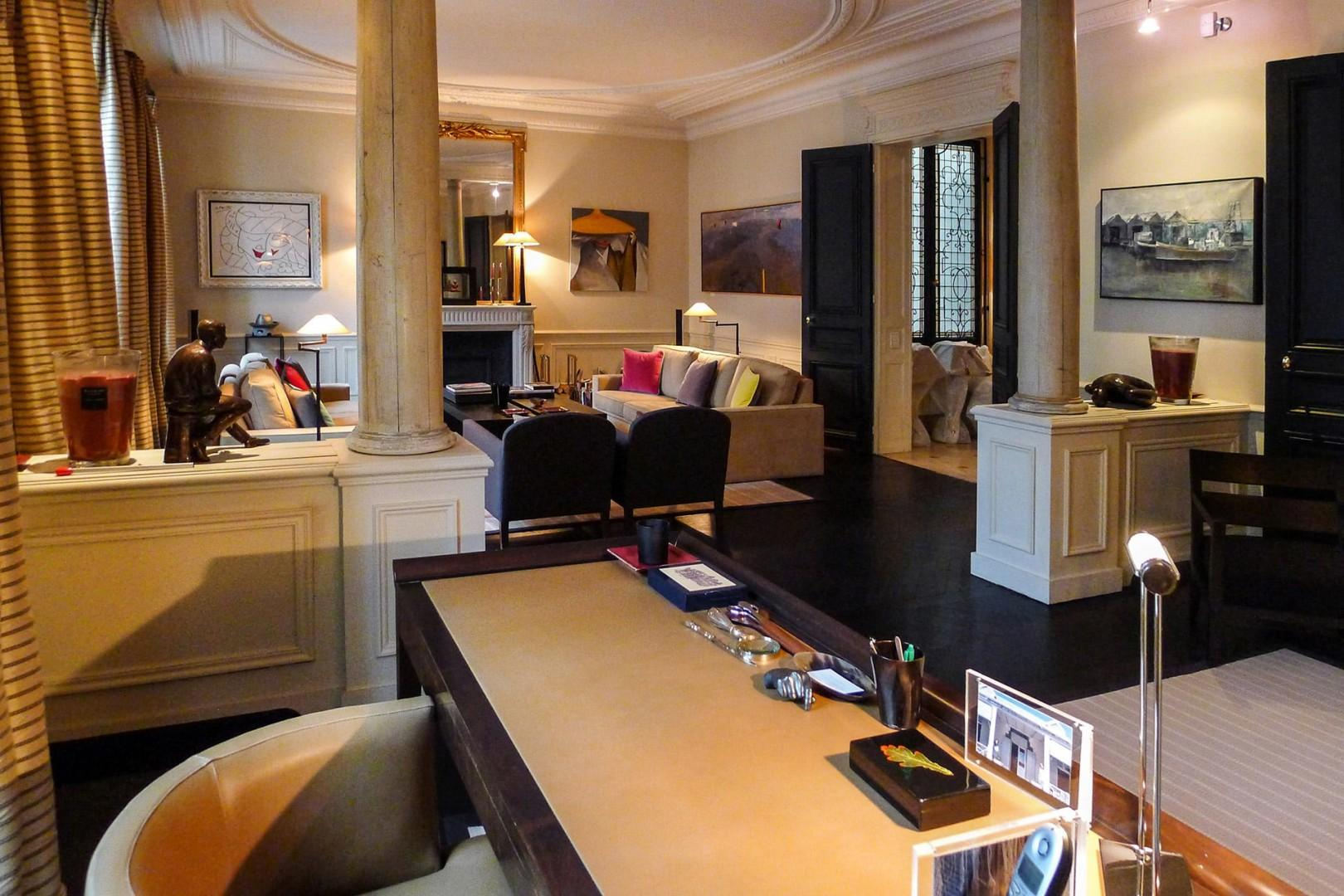 The study features a beautiful dark wood desk and leather chair.