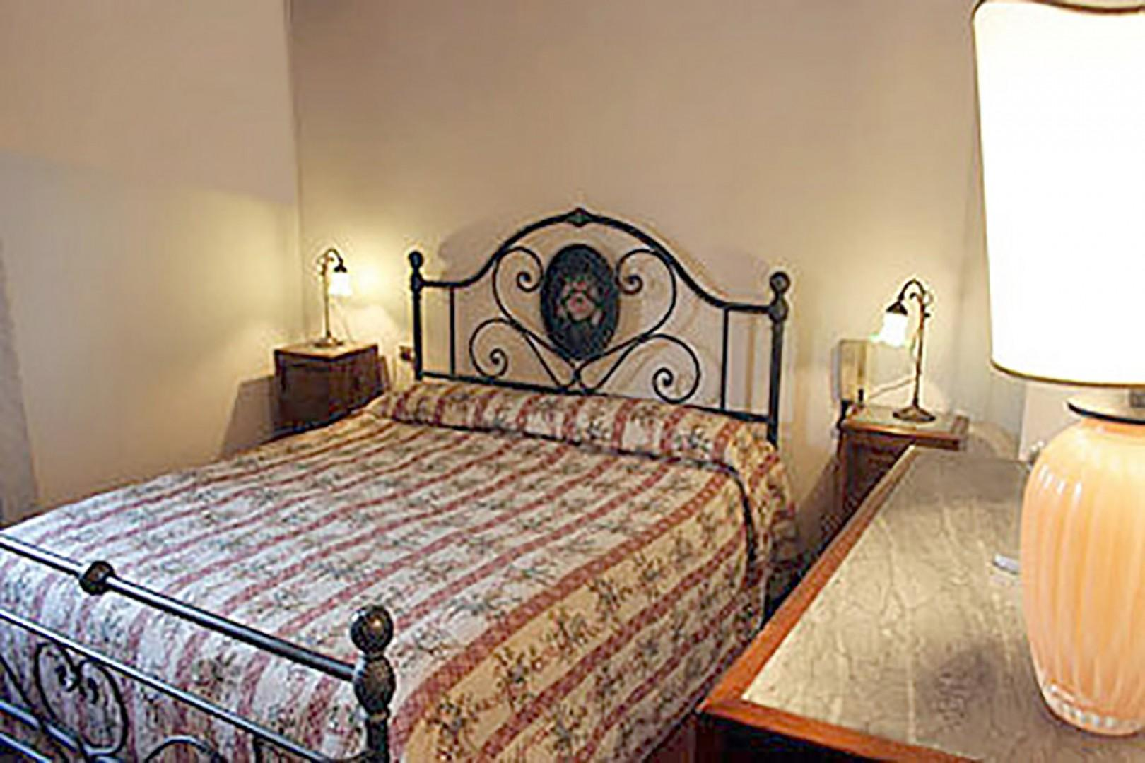 Comfortable bedroom with large bed.