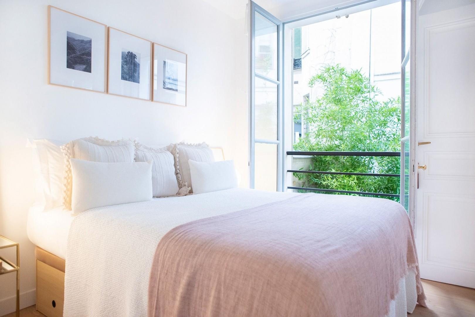 Wake up next to the French window with lovely courtyard views.