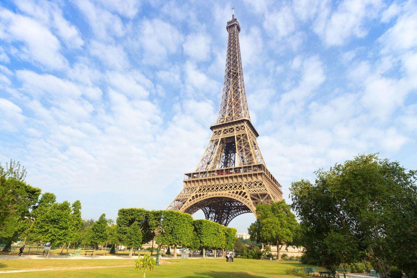 Stroll to the beautiful Champ de Mars gardens to visit the Eiffel Tower.
