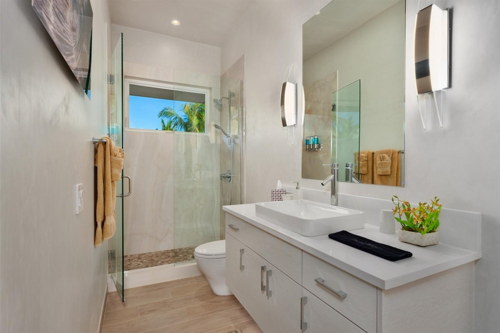 Shared Jack and Jill full bath with shower between bedrooms 7 and 8.