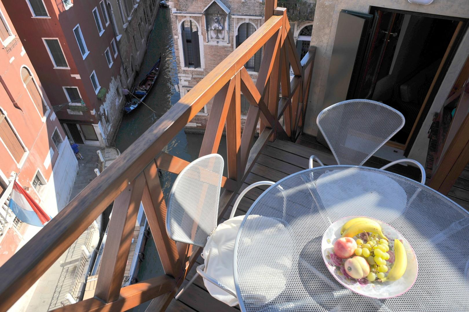 A table on the terrace welcomes dining al fresco while enjoying the view.