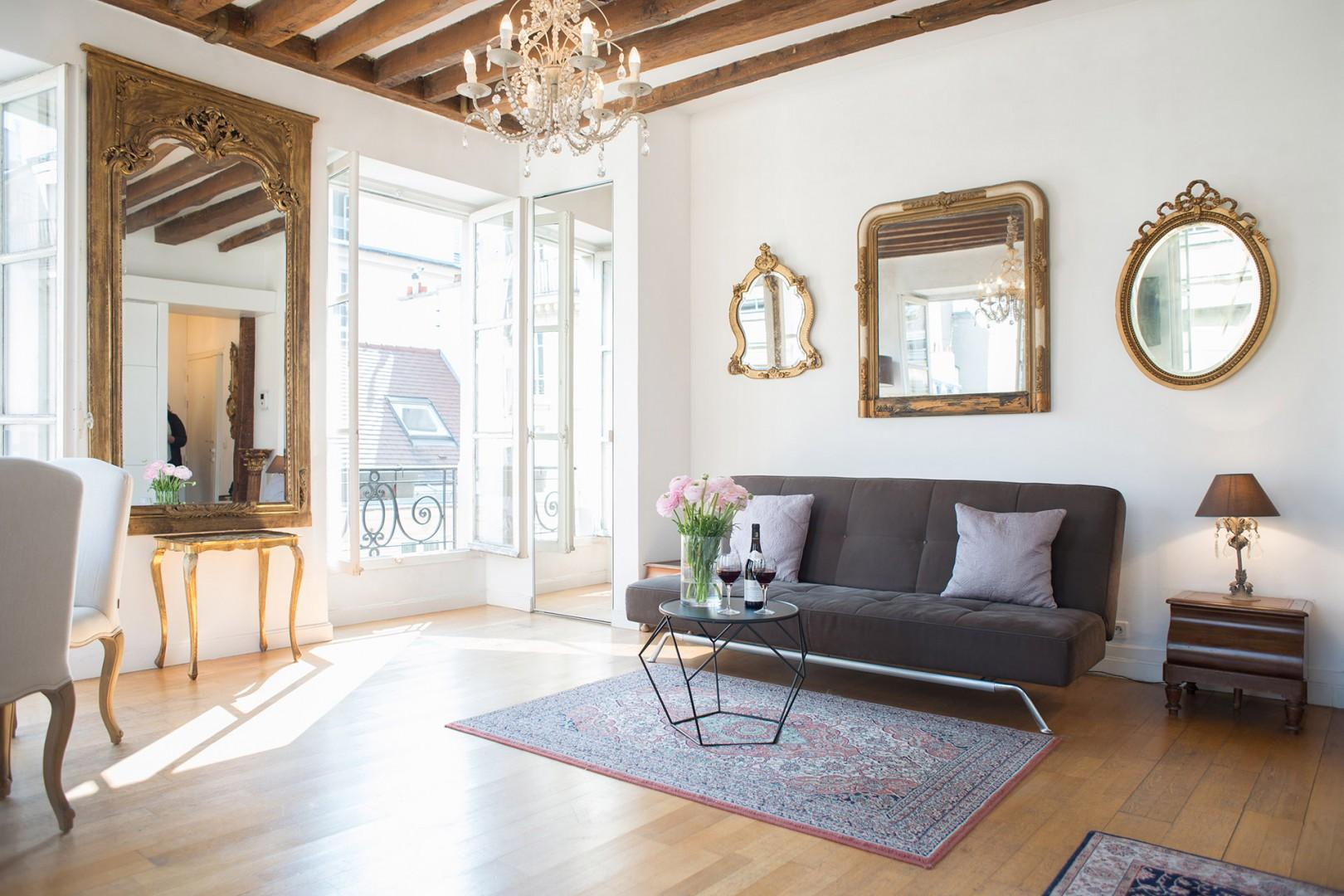 Welcome to the stunning living room with high ceilings and natural light!