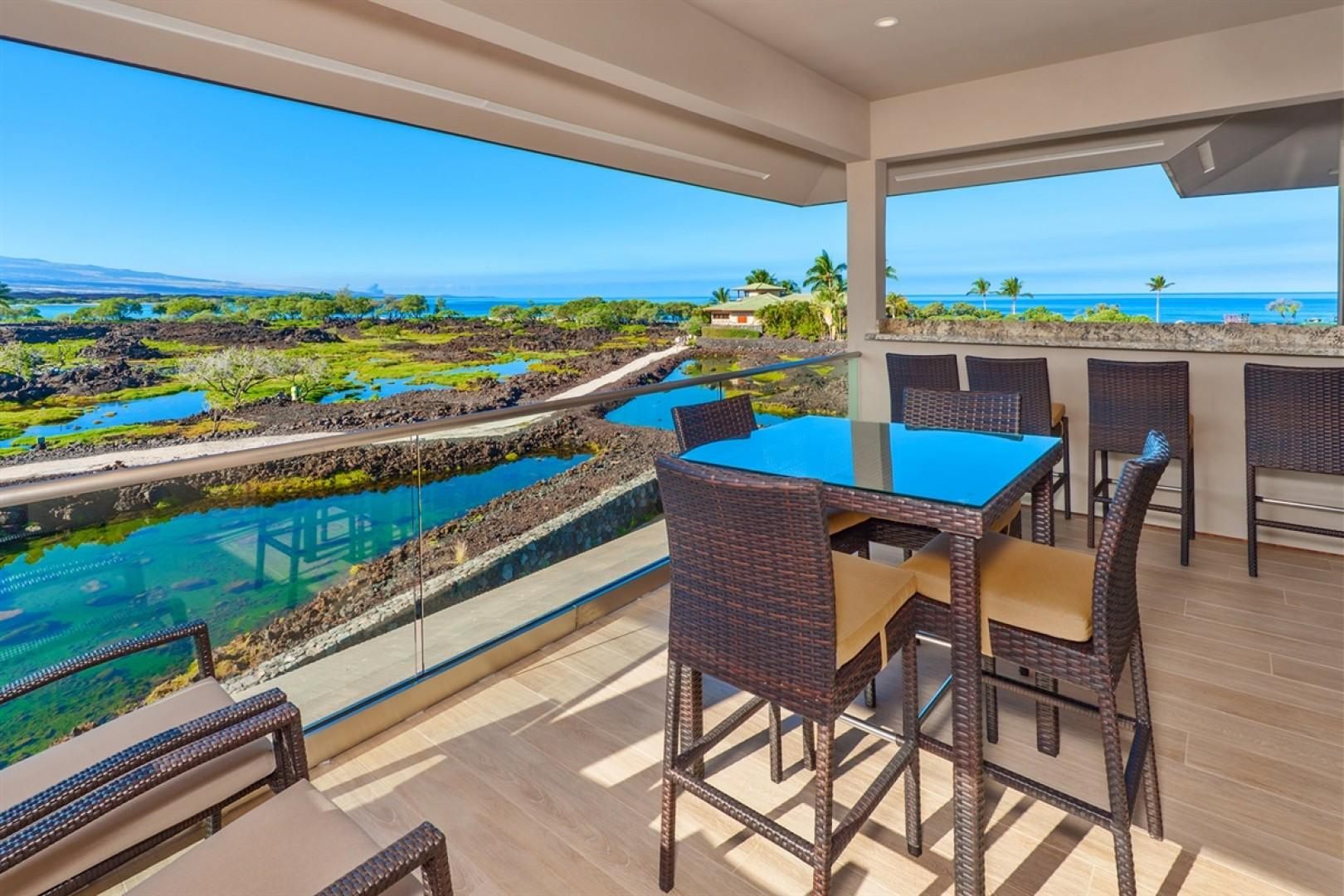 Second floor lanai with sweeping ocean, coastline and fish pond views.