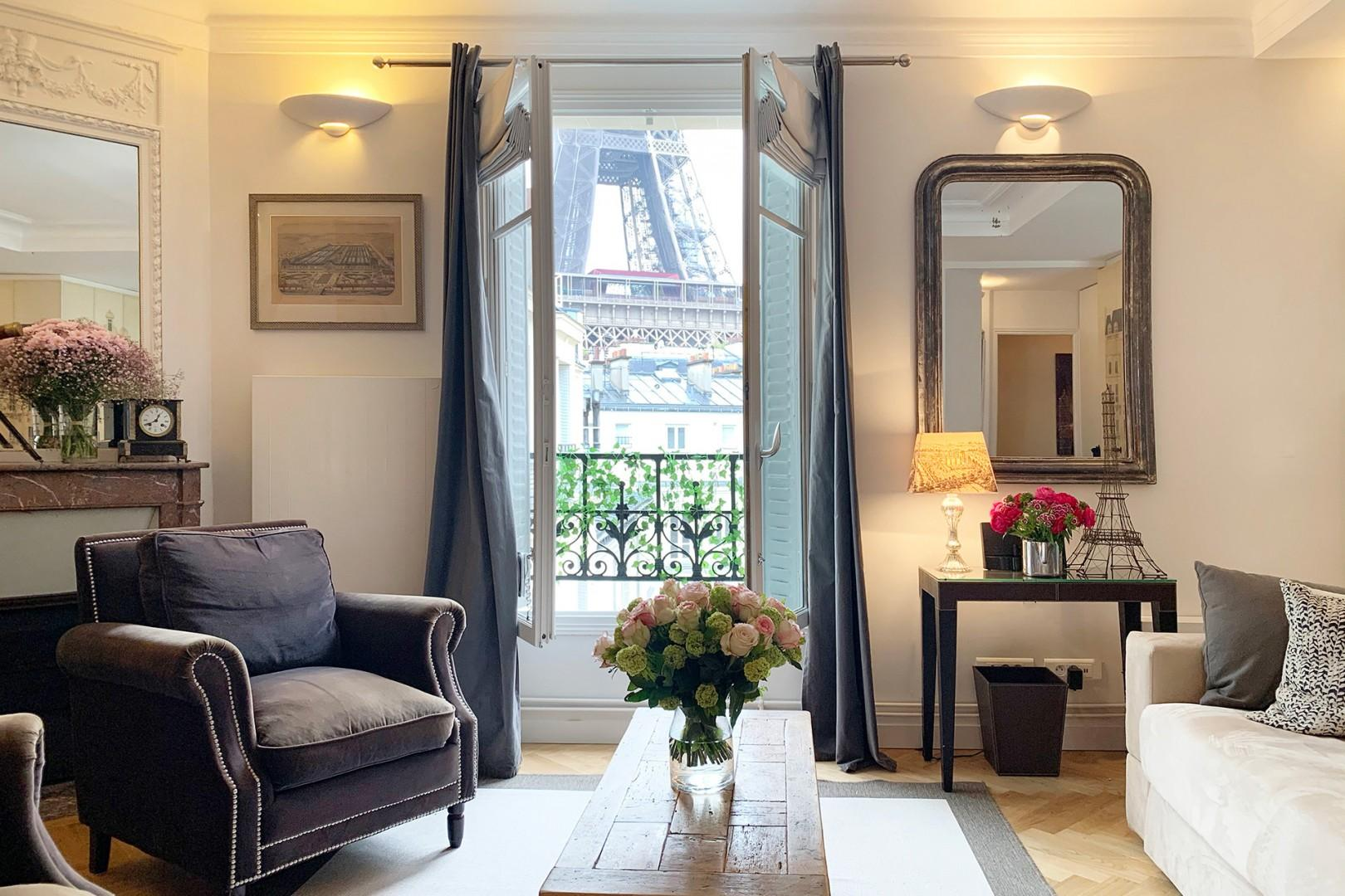 Enjoy the stunning close-up Eiffel Tower view from the living room!