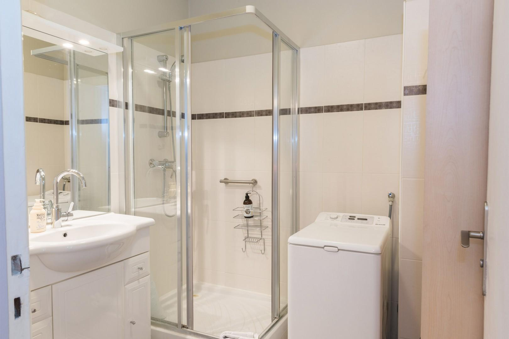 For your convenience, the bathroom features a washer-dryer combo.