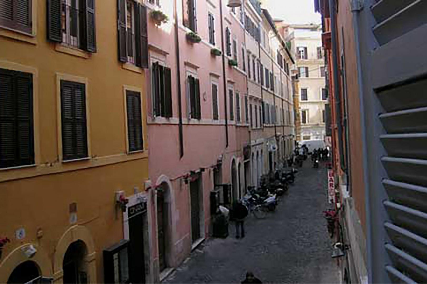 View from the apartment towards the left. Typical Roman colors adorn the buildings.