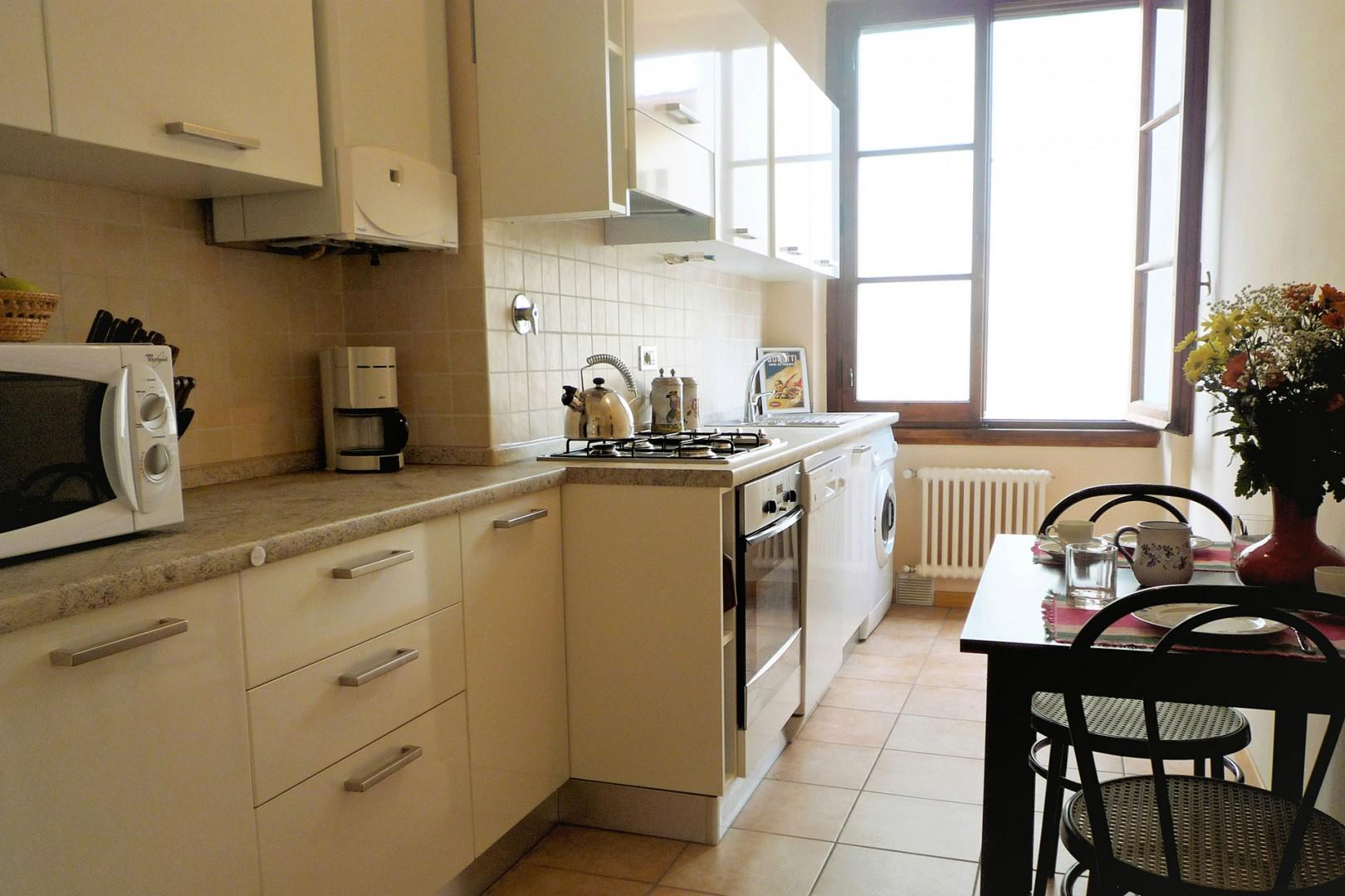 Kitchen is a cook's delight with all modern amenities, light, and a table for casual meals.