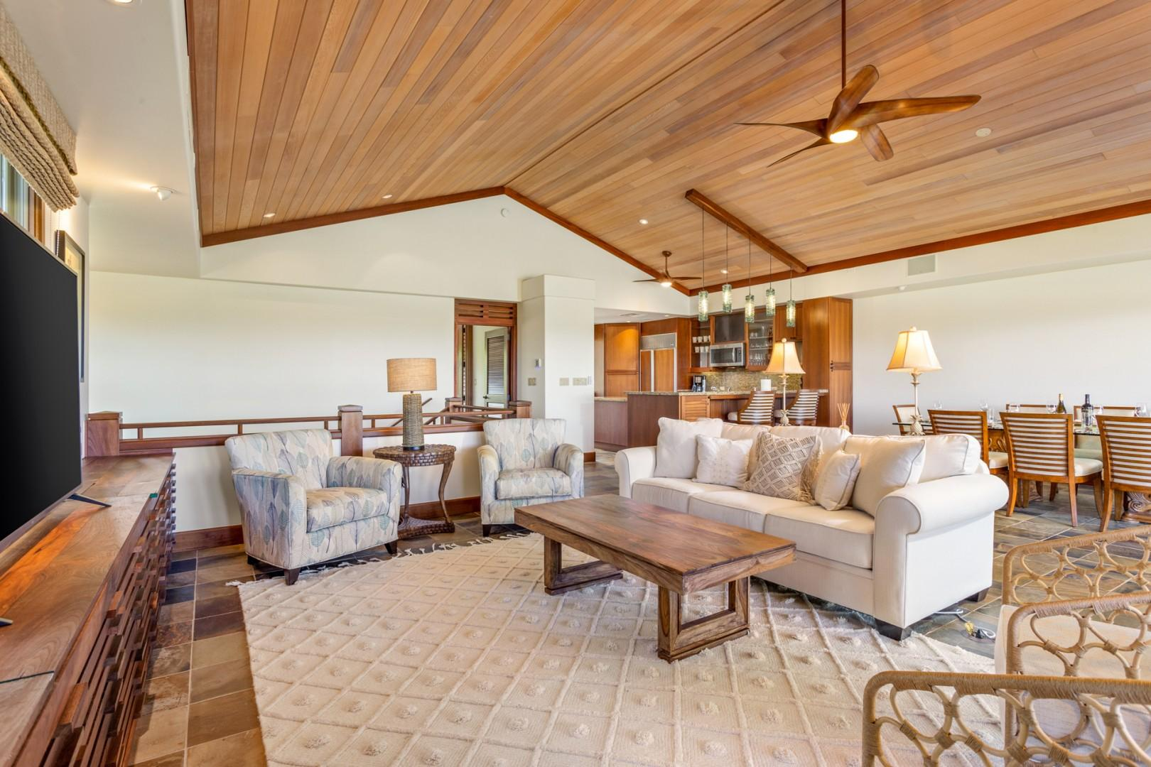 Reverse view of great room showcasing soaring ceilings and vibrant natural light.