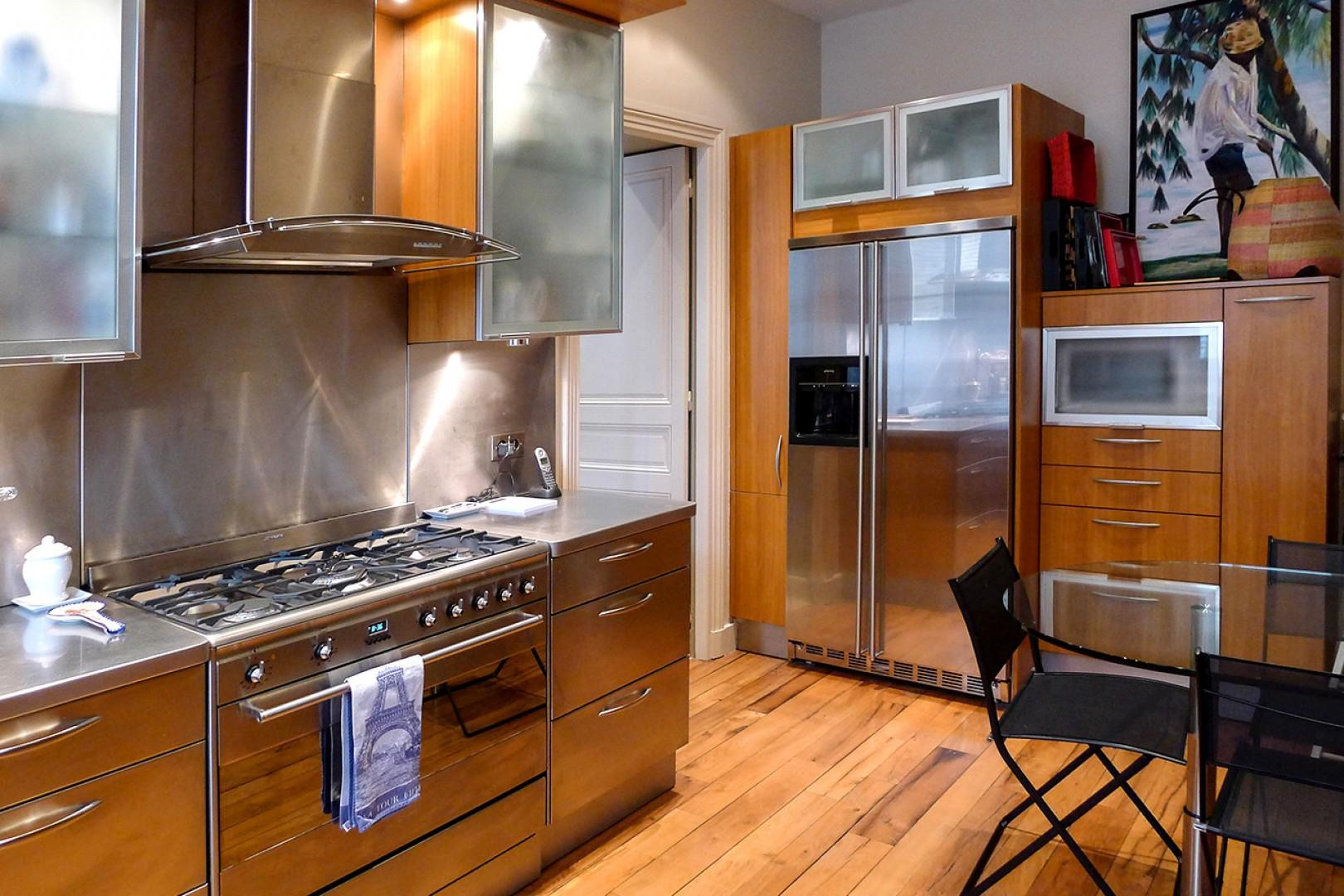 The functional kitchen features top-of-the-line appliances and easy access to the dining room.