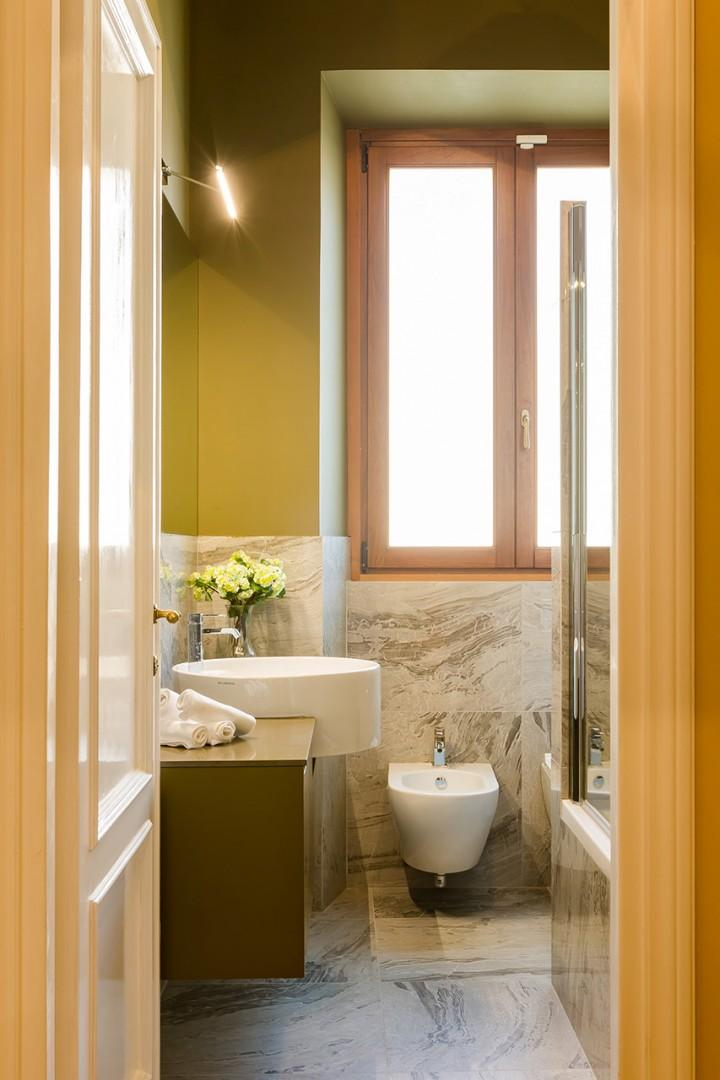 Bathroom 2 has fully enclosed glass shower with rainfall showerhead.