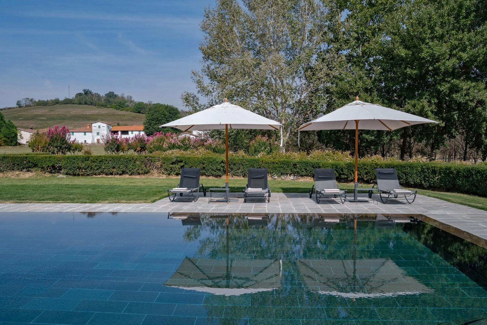 Soak up the Tuscan sun around the private infinity pool.