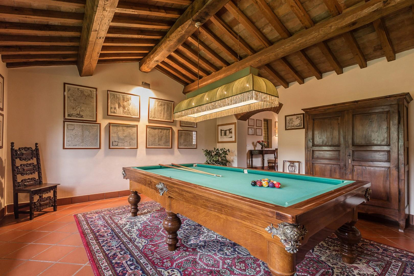 Enjoy a game of billiards! The bookcase has a small library that includes some books in English.