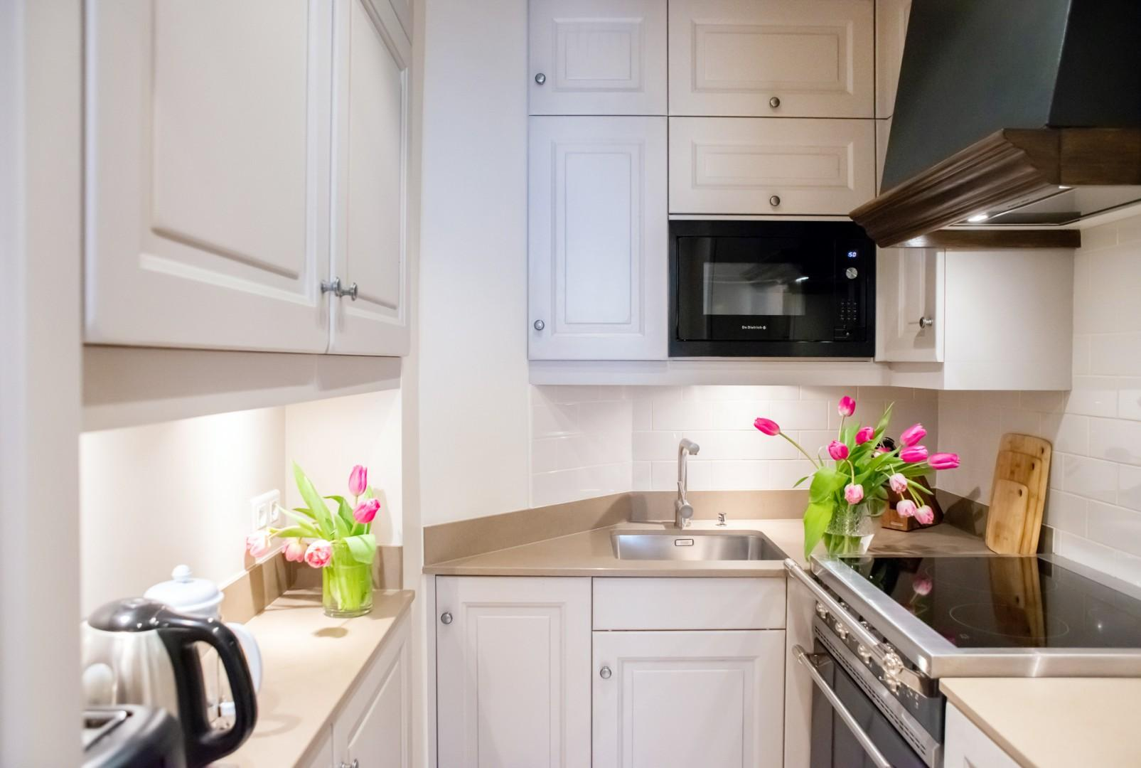 The kitchen is fully equipped for cooking at home.