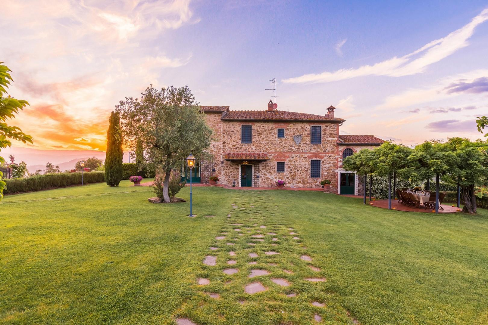 Regina is located on a large property with manicured landscaping. It adjoins olive groves.
