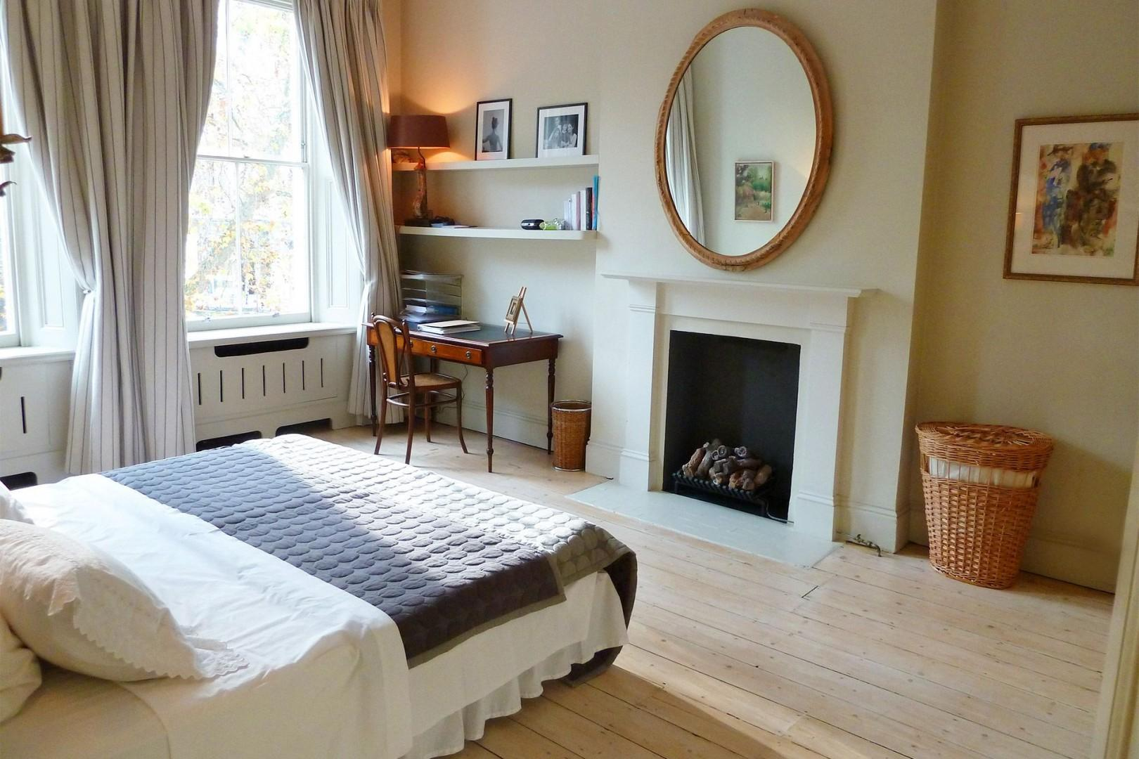 Beautiful English bedroom antiques, bleached oak floors and fireplace
