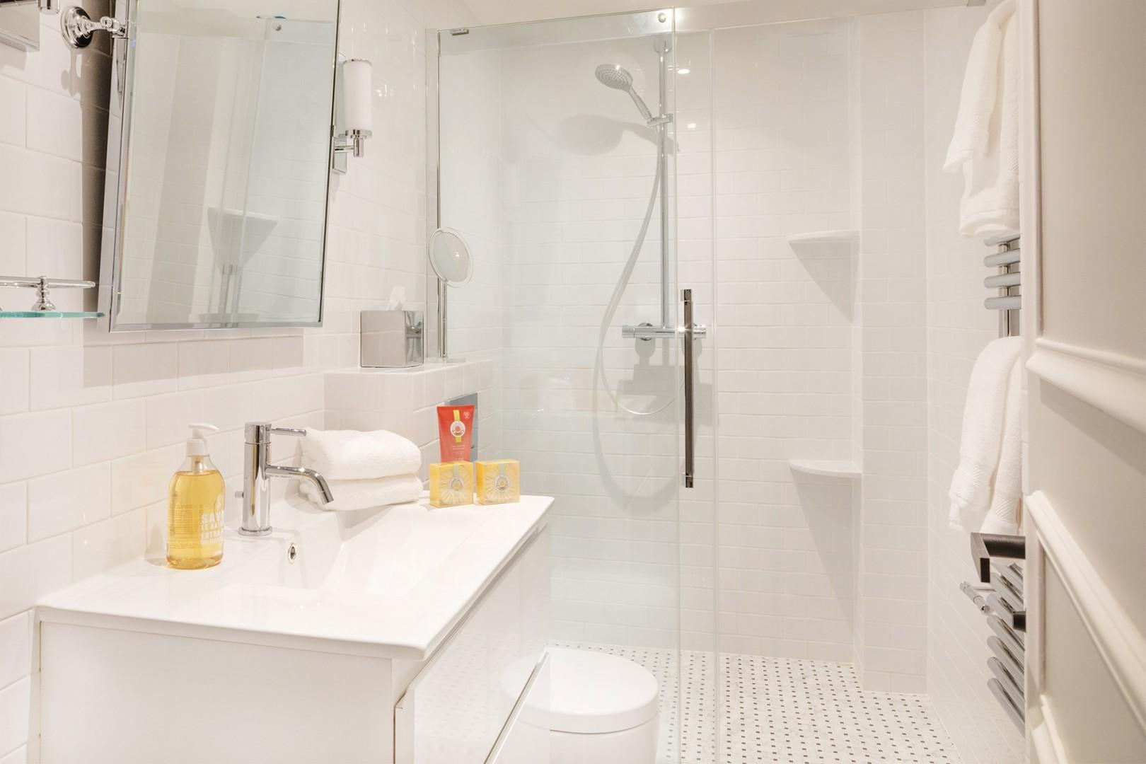 The large bathroom 2 features a shower, sink and toilet.