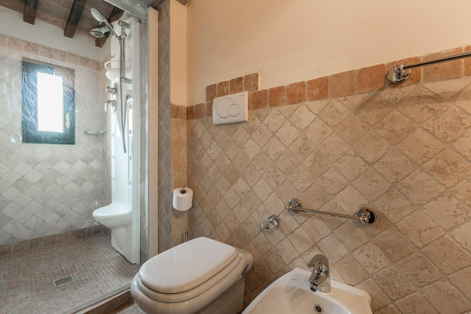 En suite bathroom to bedroom 2 with a Jacuzzi hydromassage shower.
