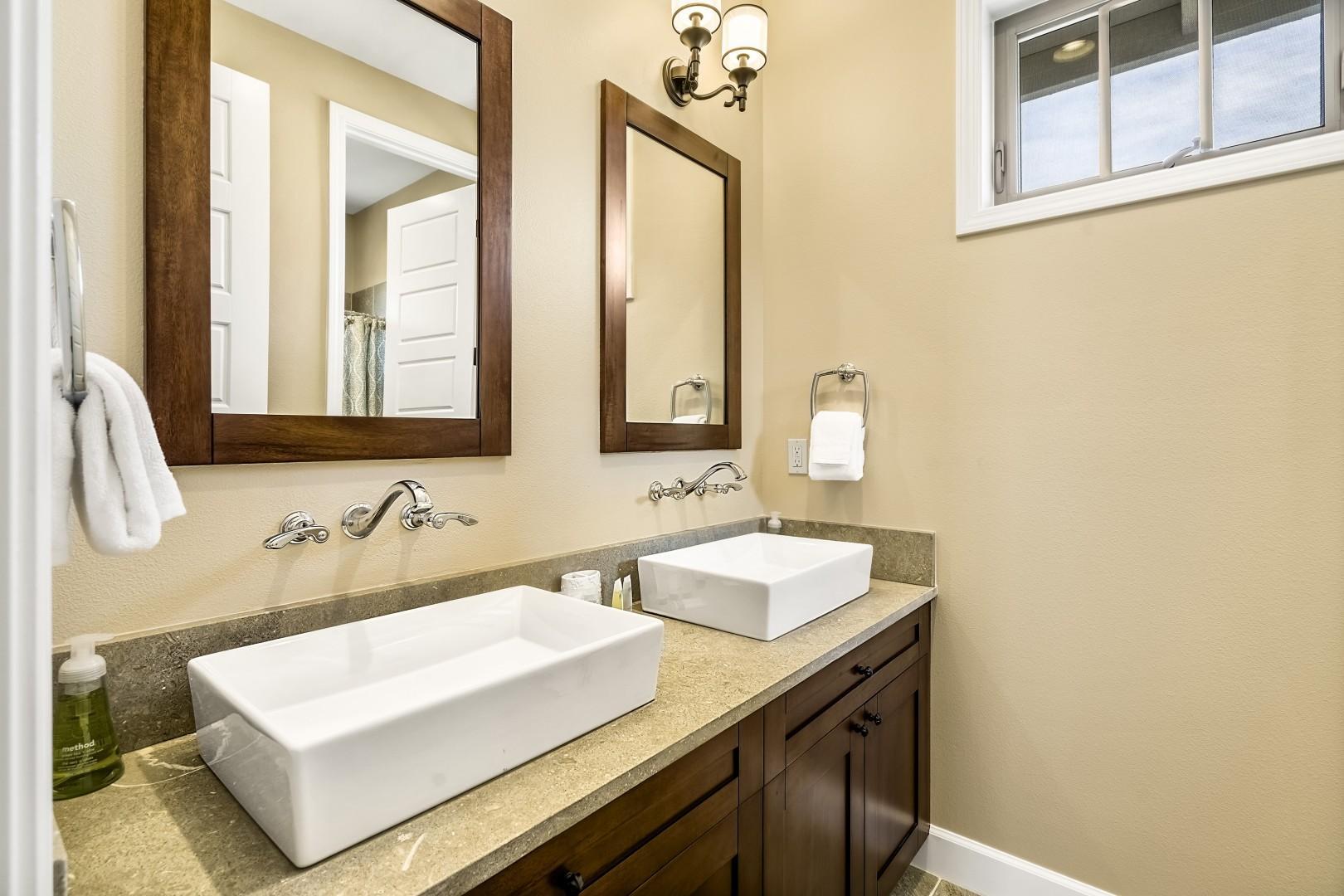 Upstairs guest bathroom with dual vanities