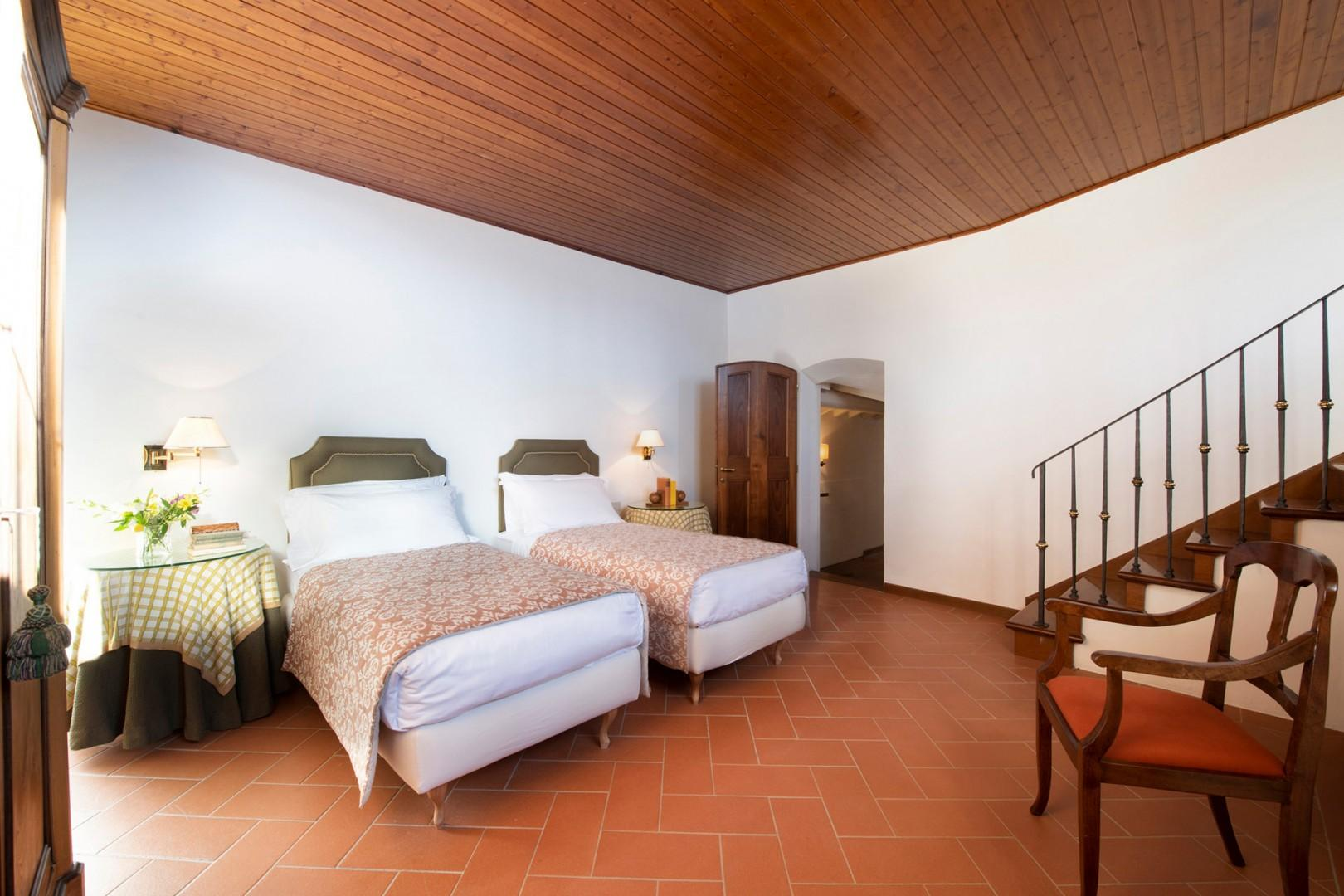 Spacious bedroom 4 with combinable beds.