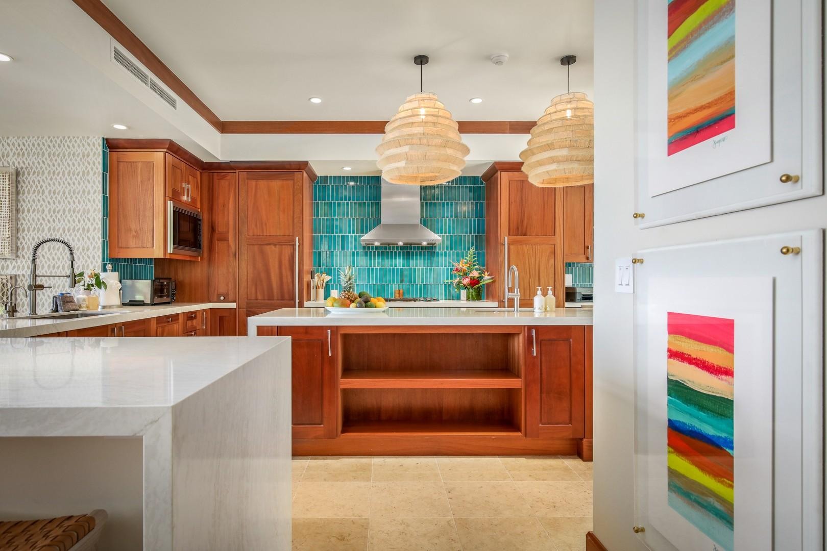Dual ocean view sinks and ample counter prep space - a chef's (or enthusiast's) dream!