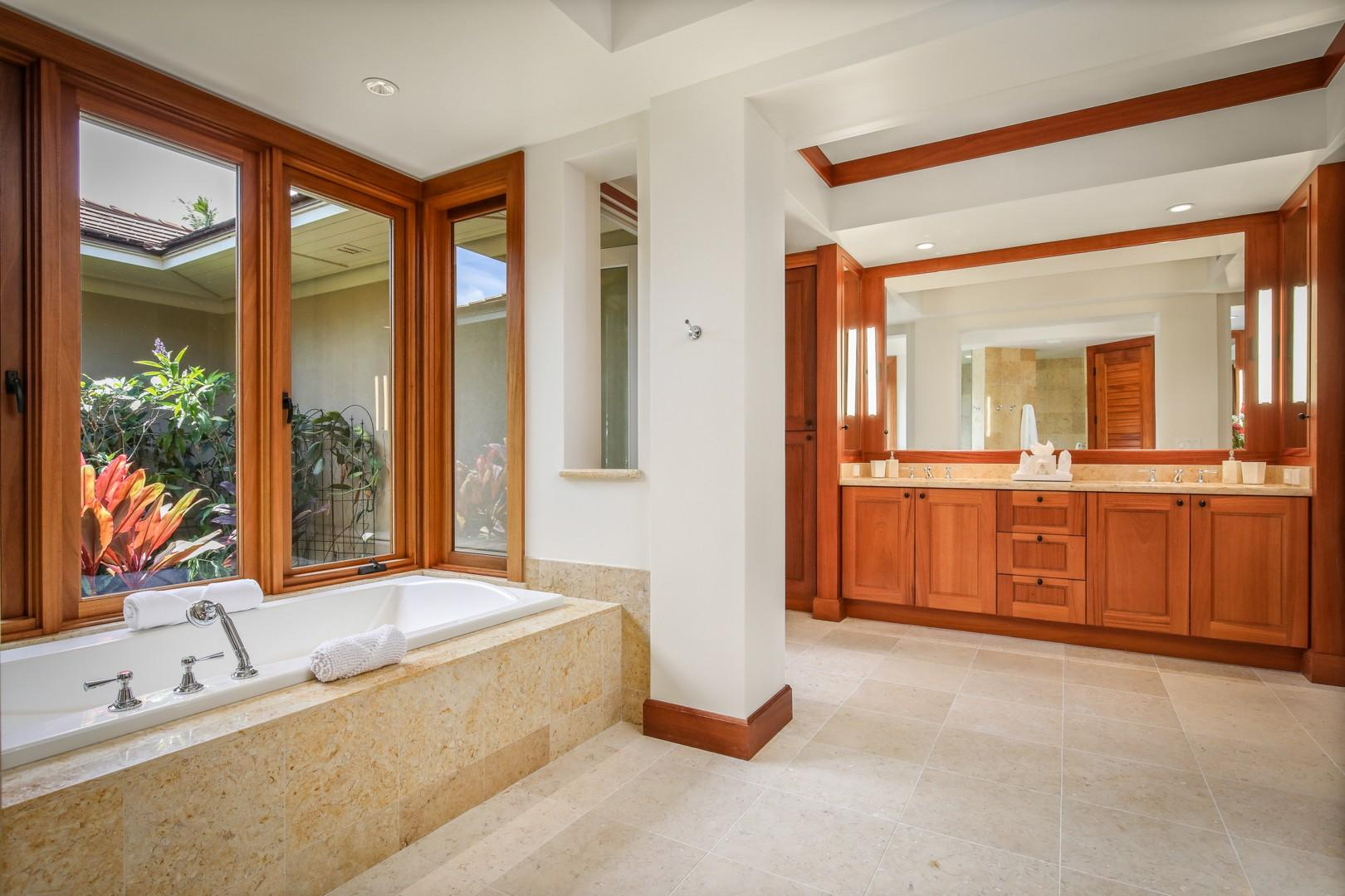 Master bath with oversized soaking tub, dual vanity, walk-in shower, and outdoor shower garden.