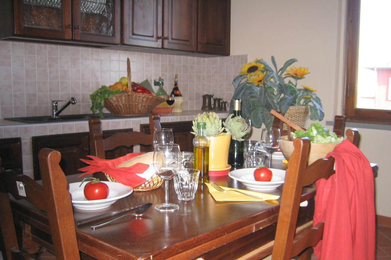 The warm and welcoming eat-in kitchen has a large countertop, the latest applicances and a grill.