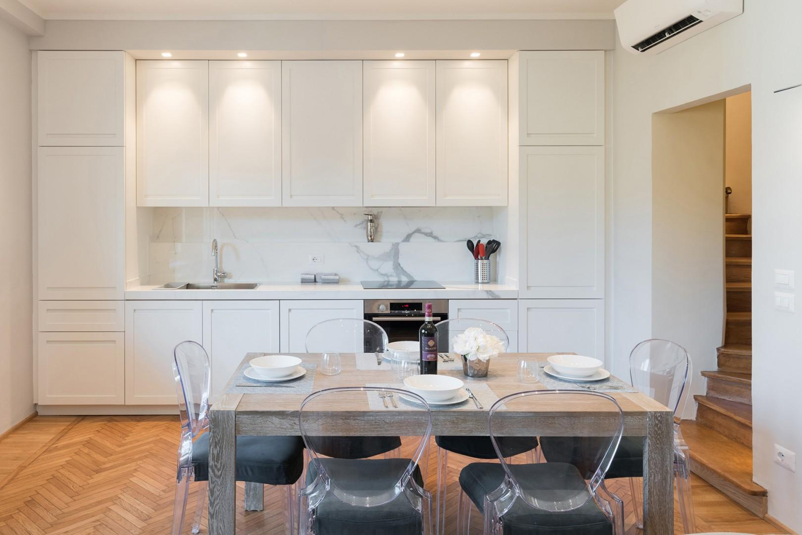 Easy access kitchen with high quality marble countertops.
