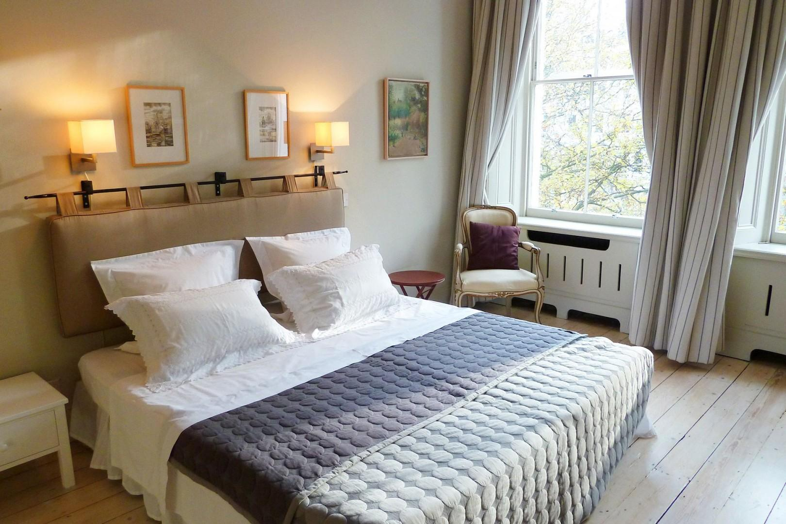 Stunning first bedroom with luxurious bed