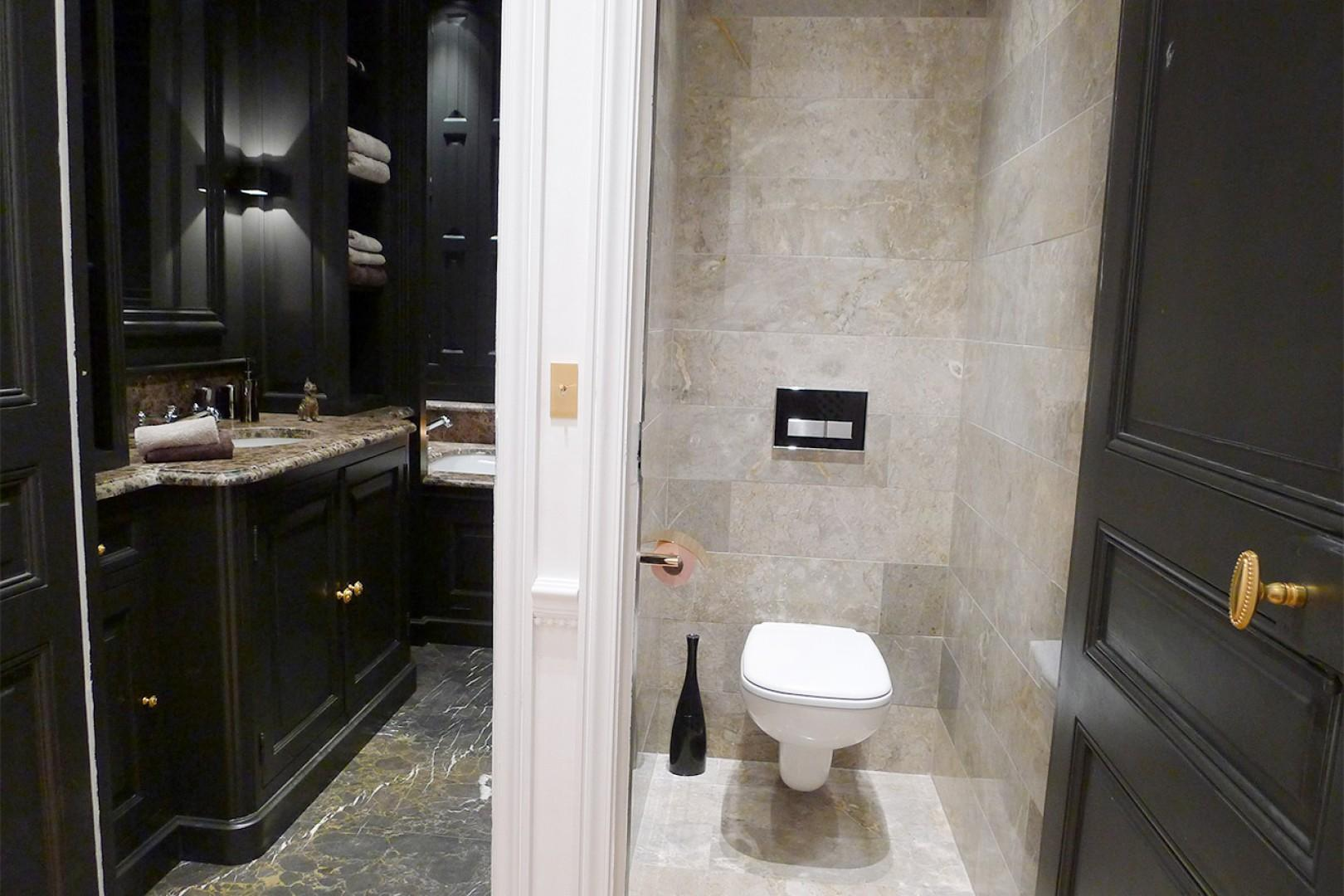 A separate half bath with toilet is conveniently located next to the bathroom.