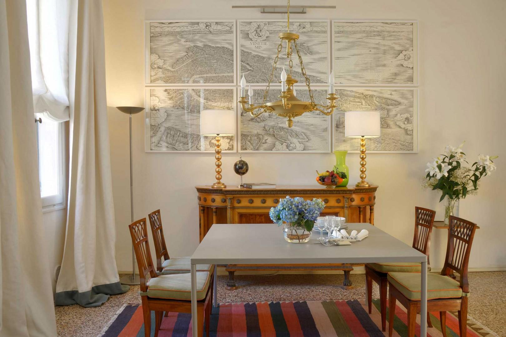 Dining room with elegant antique sideboard and specially designed chairs.