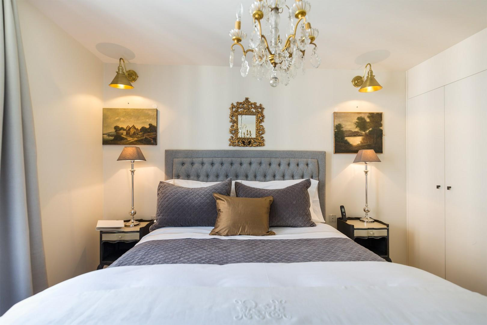 Relax with a book on the sumptuous bed.