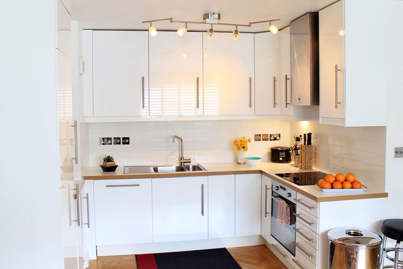 Stylish white kitchen with modern appliances