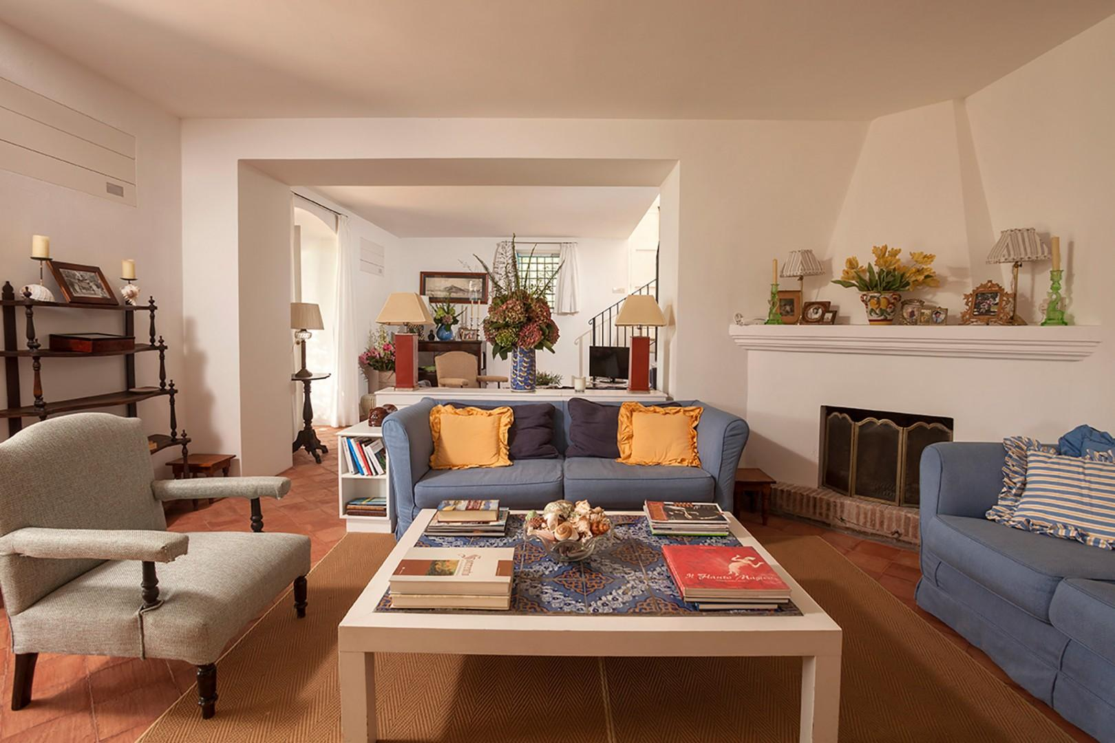 The second living room with fireplace as well as the television.